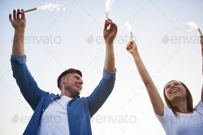 Young couple having fun with some sparklers