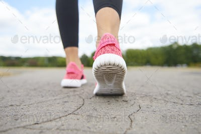 Close up of athlete's legs during running
