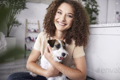 Portrait of smiling teenage girl with her dog