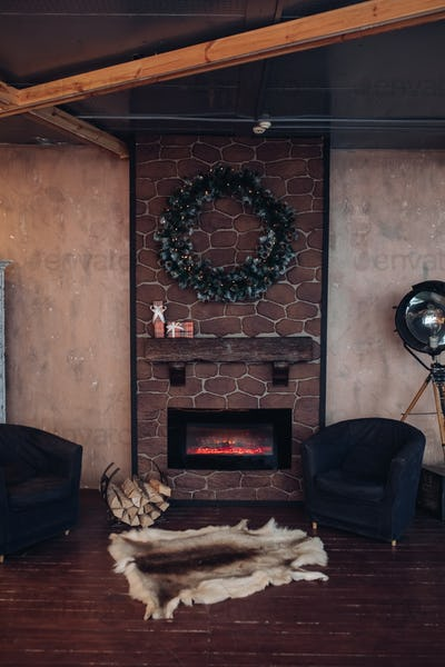A beautifully designed room with fireplace. View over the room decorated for Christmas