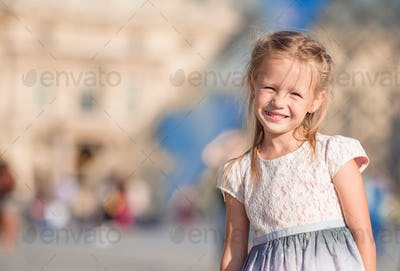 Adorable little girl during summer vacation in Paris