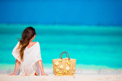 Young beautiful woman on beach vacation
