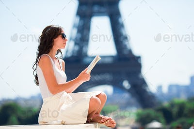 Beautiful woman in Paris background the Eiffel tower