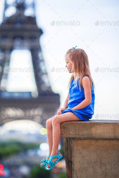 Adorable little girl in Paris background the Eiffel tower during european vacation