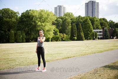 Young woman catching a short break during jogging