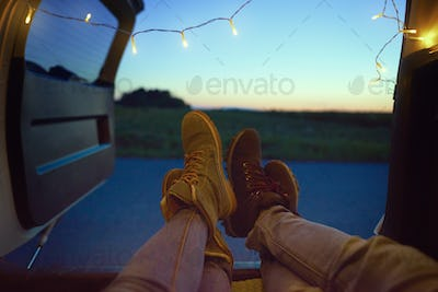 Close up of couple's legs in a car
