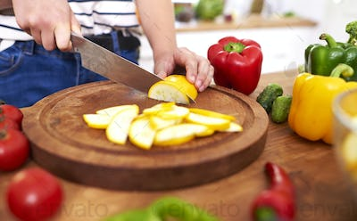 Zucchini slices on wooden board