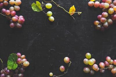 Dark Food - Fresh unpolished dark red black grapes on black slate stone background
