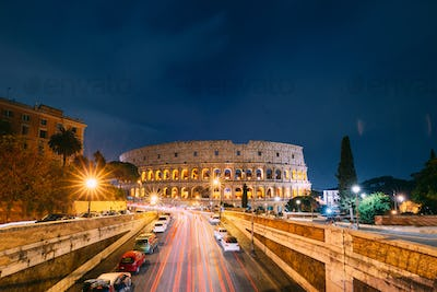 Rome, Italy. Colosseum Also Known As Flavian Amphitheatre In Evening Or Night Time