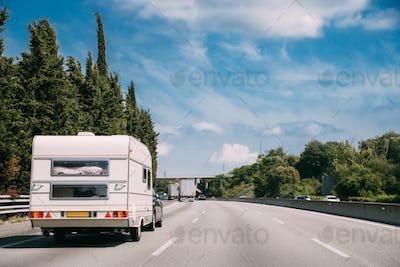 White Caravan Motorhome Car Goes On Highway Road