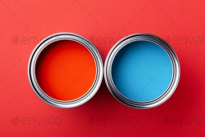 Two Cans of Paint. Red and Blue.
