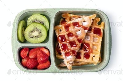 Lunch box with delicious food on a white background