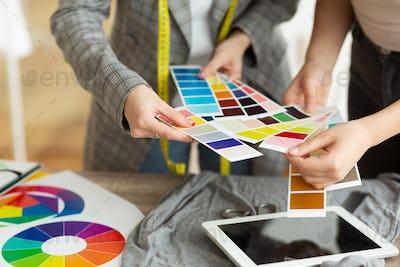 Fashion designer choosing color samples in atelier