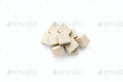 Cubes of fresh soybean Tofu cheese isolated on white