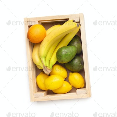 Fresh and eco fruits inside wooden box isolated on white