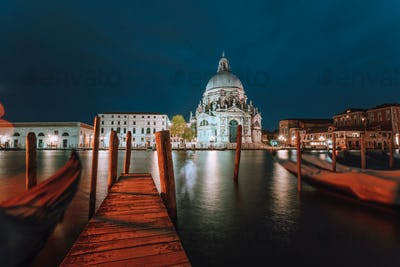 Canal Grande and Basilica di Santa Maria della Salute illuminated at dusk night time. Venice, Italy