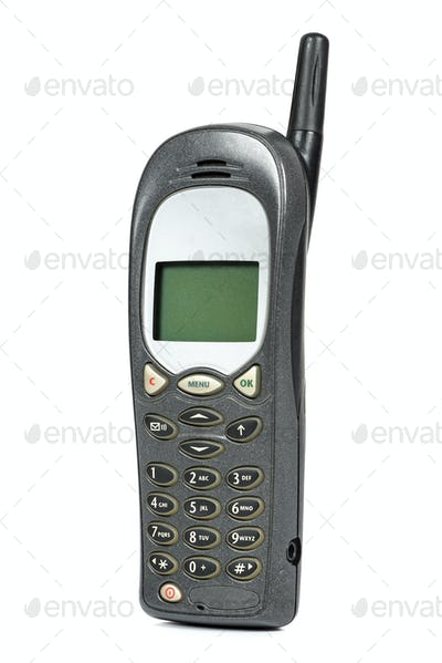 Old mobile phone on white background