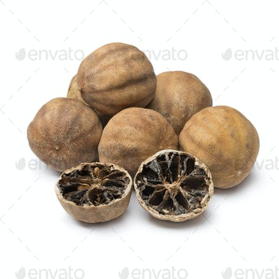 Whole and halved dried white limes