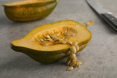 Seeds of a halved fresh acorn squash close up