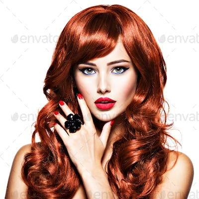 Beautiful sexy woman with long red hair. Fashion Portrait
