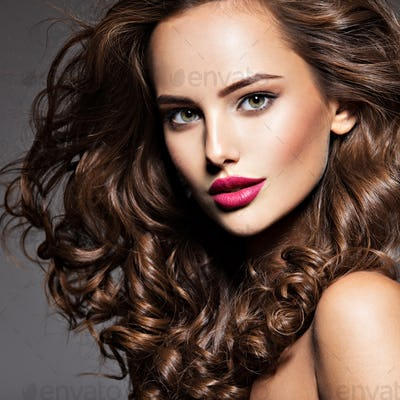 beautiful face of young  woman with long brown hair