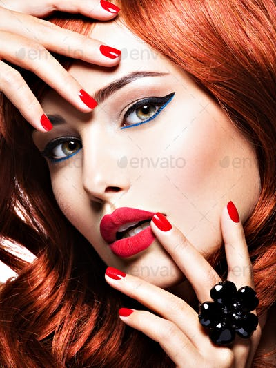 Beautiful sensual woman with  red nails. Fashion makeup.