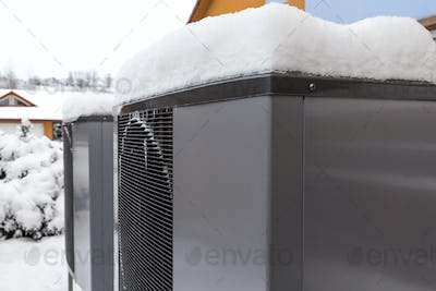 Two residential modern heat pumps