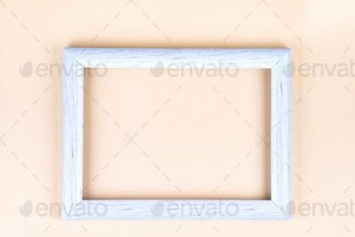 Distressed white painted picture frame, isolated on beige, copy space