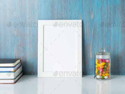 mock up frame on blue wooden wall
