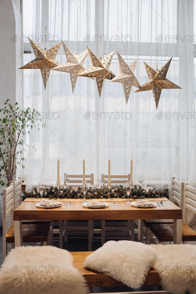 Dining table with decorative fir branches. Christmas holidays