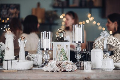 Candles and Christmas decorations on table in room