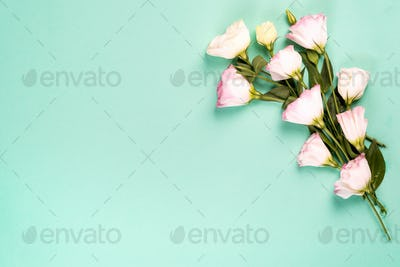 Frame composition with empty space in the center made of blooming pink eustoma, flat lay. Floral