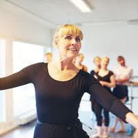 Mature woman doing ballet in a dance studio