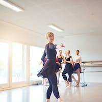 Mature woman practicing ballet in a dance studio