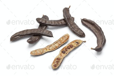 Whole and half Carob pods