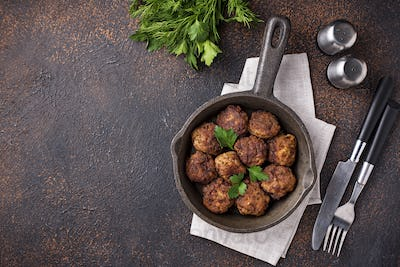 Homemade beef meatballs in frypan