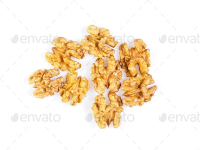 Top view with a handful of walnut, circassian nuts isolated on white background