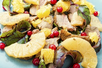 Meat salad with pineapple.