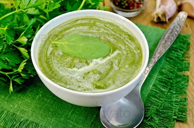 Puree green in a bowl on the board with spinach