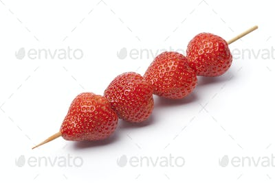 strawberries on a wooden stick