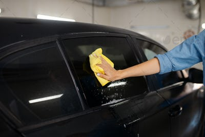 Female washer with sponge wipes automobile glass