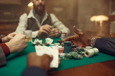 Male poker players at gaming table, casino