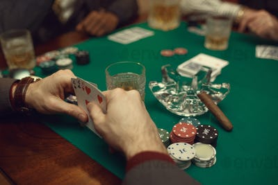 Poker players at the table with cards and chips