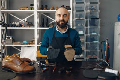Bootmaker repairing the shoe, footwear repair