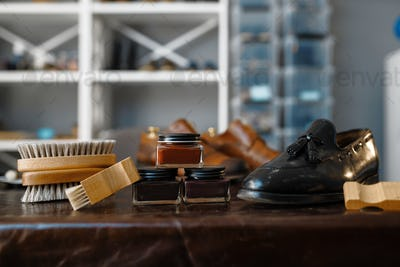 Shoe repair service concept, boots and polish