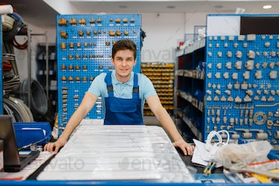 Plumber poses at the counter, plumbering store