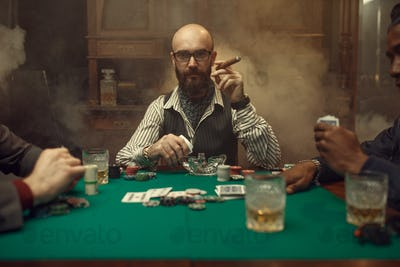 Bearded poker player with cigar, casino