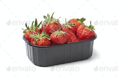 Plastic box with fresh strawberries