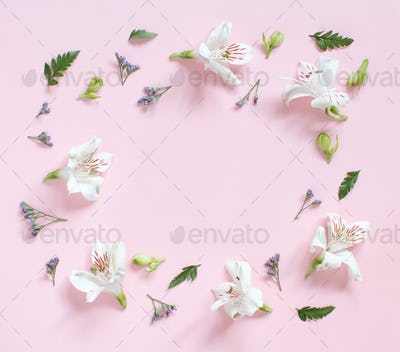 Flowers and petals on a light pink background