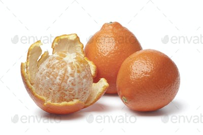 Whole and peeled Tangelo